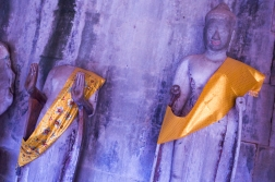 Colours are not totally absent, however. The statues at Angkor Wat often get decorated for religious purposes.