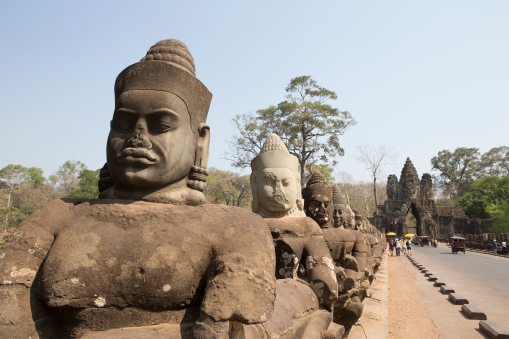 This is the entrance to Angkor Thom, a city within the Angkor complex that was built in the late 1100s. The four entrances to the city were all guarded by huge stone figures carrying a gigantic snake.