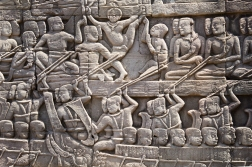 An important event in Khmer history is the battle of Tonle Sap Lake, not far from Siem Reap and the city of Angkor. It was here that the Khmer king Jayavarman VII defeated the Cham invaders (the then Cham kingdom is today part of South Vietnam) who had raided Angkor Wat. To prevent this from happening again Jayavarman built the fortress city of Angkor Thom. On a wall in Angkor Thom this relief showing scenes from the battle can be found.