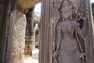 An Apsara, an image of a topless beauty, guards a doorway at Angkor Thom.