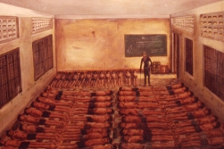 This is how most of the prisoners were kept, chained to the floor in what used to be classrooms. The paintings in the museum are made by former inmates.