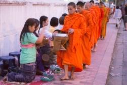 Early morning food gathering. Luang Prabang, Laos.