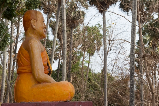 A statue of a monk overlooking the Mekong. Hanchey, Cambodia.