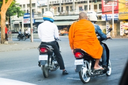 If a monk wants a ride you are supposed to pick him up and let him travel for free. Phnom Penh, Cambodia.