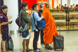 At airports you let the monk come to the front of the line, and at the gate he gets priority boarding. Phnom Penh, Cambodia.