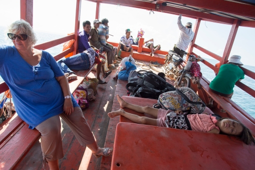 Cambodian local transport is colorful and crowded, but the boat is far more pleasant than most of the buses.