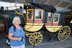 One stop of the route is the Swiss transport museum. Here ES is admiring a very old post carriage.