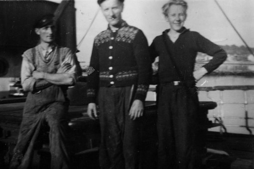 The Grandfather, centre, and the young uncle, on «Dronningen» in 1946.