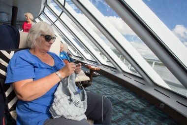 ES on the light top deck of the Polarlys, enjoying the view and her knitting.