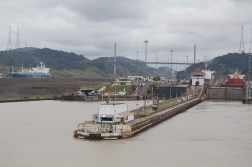 Leaving Pedro Miguel, heading for Miraflores. The blue colored vessel to the far left is still on the level of the Gatun lake. She is on her way to the brand new set of locks made for the bigger ships.