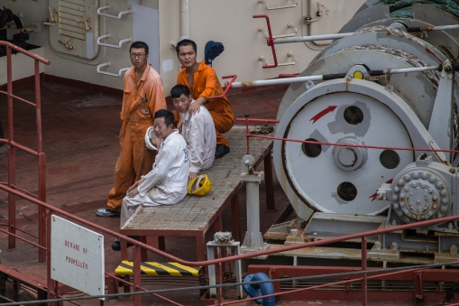 Crewmen on the Interlink Equity, relaxing on deck while travelling with us thru the canal.