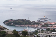 Our ship at anchor in St George, completely dwarfing the little town she is visiting.