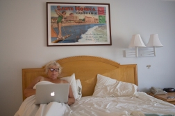 A night away from our Luminosa home, ES checking e-mails in room 210 at the Ocean Lodge Hotel, Santa Monica.