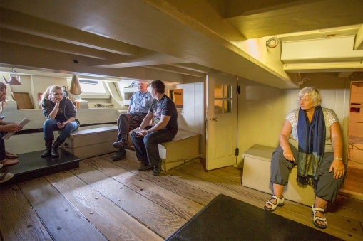 The Endeavour was built to carry coal along the coast of England. In 1768 an extra deck was put in to accommodate all the men that were going with Cook, and to save space one of these decks was very low indeed. This is the officer's quarter, and when ES sits down her head is exactly the height of the lowest beam.