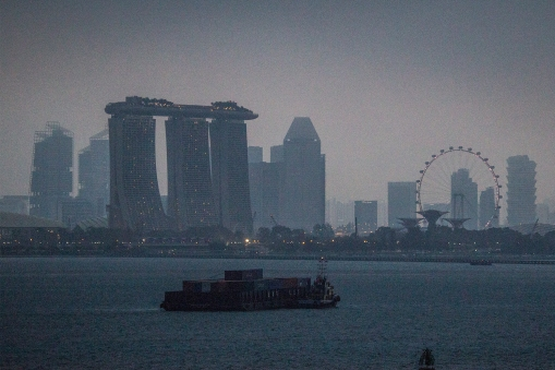 Arriving Singapore at dawn. There is no mistaking this skyline.