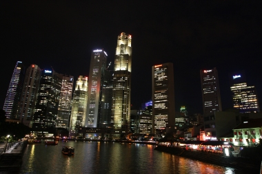 The Boat Quay at night, from two different angles.