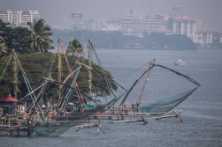 They call them the Chinese fishing nets. They are suspended to a huge wooden structure and lowered into the sea.