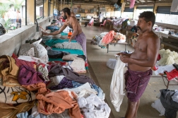 After drying it is time for ironing and folding. This picture is from a similar, but much smaller, laundry in Cochin. Like in Mumbai, the workers are all men.