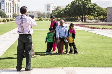 A local family visiting the mosque, having their picture taken.