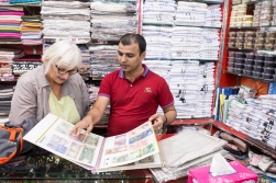 Having had costumers from all over the world, he has built up an impressive collection of bank notes that he is happy to show.