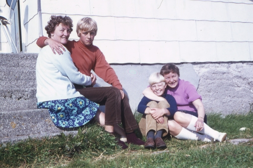 On the kitchen stairs in 1970. The Tall Cousin and the Polite Cousin with various aunts.