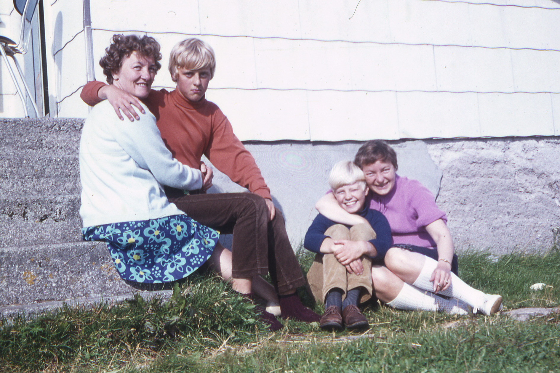 On The Kitchen Stairs In 1970. The Tall Cousin And The Polite Cousin With  Various