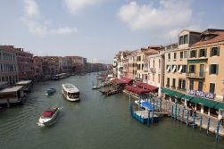 The Canal Grande seen from Rialto Bridge. Make a note of the slogan on the building to the right.