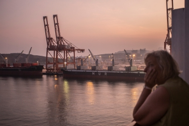 Leaving Salalah. The sunset can make even a container harbor look romantic.