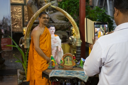 Not only the tourists flash their cameras around, also visiting monks make sure they have their pictures taken.