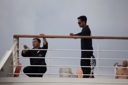 We are on a ship, but we very rarely see the actual sailors! Here two of them are doing what sailors always do, maintenance.
