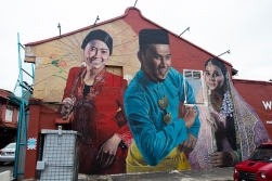 Street art welcoming visitors - and motorist - to Malacca.