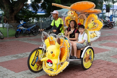 The very colorful bicycle taxis are typical of Malacca.