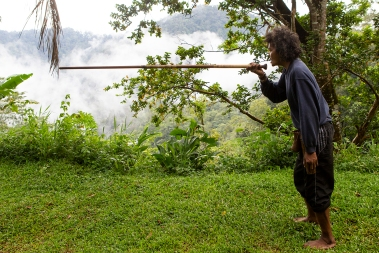 A local expert of the art of blowpipe hunting demonstrating his skills.