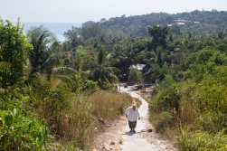 Going for a walk up the hill at the north end of the beach. Some of the tents and buildings at Robbie's resort can be seen amongst the trees in the background.