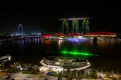 Marina Bay Sands, here sporting a late night laser light show, seen from the Fullerton.