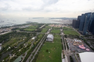 The land around the Marina Bay Sands is former ocean, and this is probably not done to create flat green wasteland. We fully expect the skyscrapers to creep across these fields in the decades to come.
