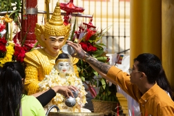 Pouring water onto Buddha statue is a gesture of worship and brings the worshipper prosperity and happiness.