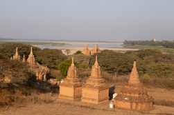 The landscape of Bagan where temples and pagodas dominate wherever you look. Here we have found a little hilltop overlooking the Irrawaddy river.