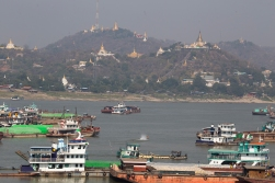 Temples and boats at the busy river town of Sagaing some 20 kilometers before arriving in Mandalay.