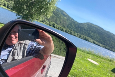 Driving north! DHH takes a selfie by the side of a river between Oslo and Trondheim.