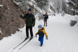 Going skiing with The Grandson roaming free. The road past our house was once upon a time built as a railway line. The tracks are long gone, but the road remains and is used for hiking in the summer and skiing in the wintertime.