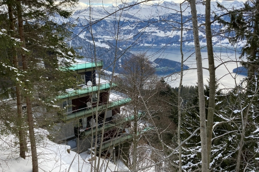 Our house overlooking the lake, 1000 meters below us! We live on the middle floor, but on the far side of the house seen from this angle.